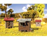 модель Faller 120211 Trackside Buildings/Shanties. Набор для сборки (KIT), пластмассовые детали -- 3 Different Weathered Wooden Sheds