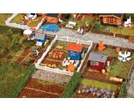 модель Faller 272551 Allotment Garden, набор № 2. Набор для сборки (KIT), пластмассовые детали -- 3 Different Garden Sheds, Fences, Tables, 3 Landscape Bases & More