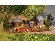 модель Faller 272552 Allotment Garden, набор № 3. Набор для сборки (KIT), пластмассовые детали -- 2 Different Garden Sheds, Fences, Tables, 2 Landscape Bases & More