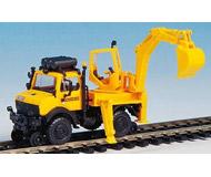 модель Kibri 16307 Автомобиль UNIMOG экскаватор на железнодорожном ходу.