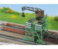 модель Kibri 37442 Traveling Coal Crane. Размер   34 x 12 см. Набор для сборки.