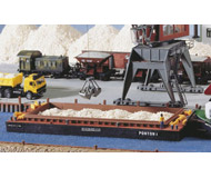 модель Kibri 38524 Bulk Material Loading Barge. Размер  27.5 x 9 x 2.8 см. Набор для сборки.