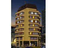 модель Kibri 48218 High-Rise Apartment/Commercial Building w/Interior Lighting Starter Set -- Kit. Размер 20 x 18 x 34 см. Набор для сборки.