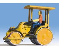 модель Noch 16767 Асфальтоукладчик (желтый) с фигуркой человека.